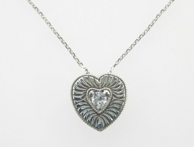 heart shaped pendant with a diamond in the middle